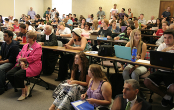 It was standing room only as more than 100 members of the SMC community packed the hall for the panel discussion on Syria.