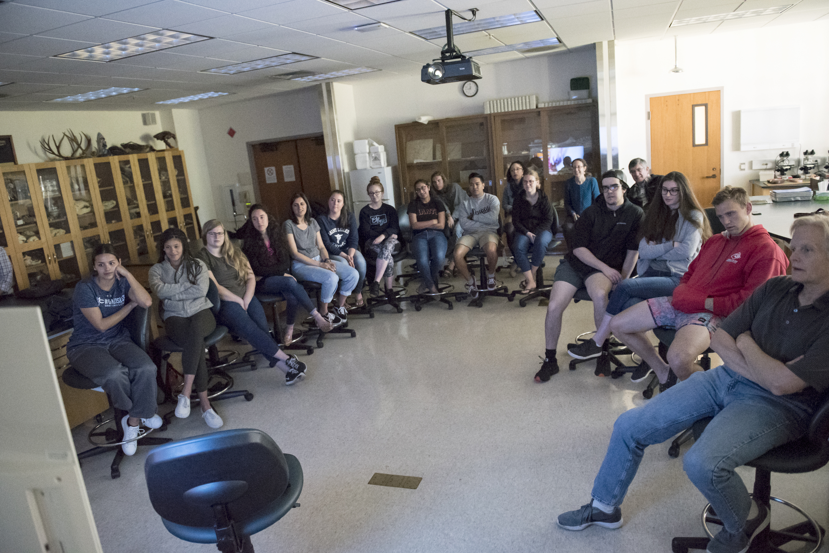 Science students interact with surgeon during live telesurgery.