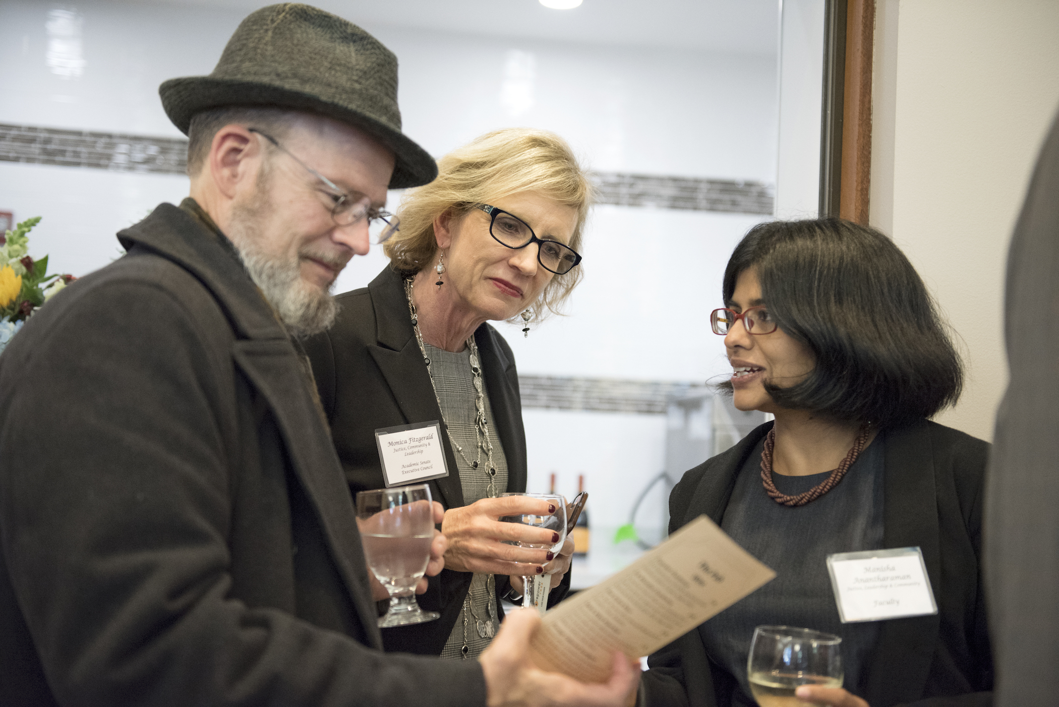 Board of Trustee member and History Professor Brother Charles Hilken with JCL Professors Monica Fitzgerald and Manisha Anantharaman.