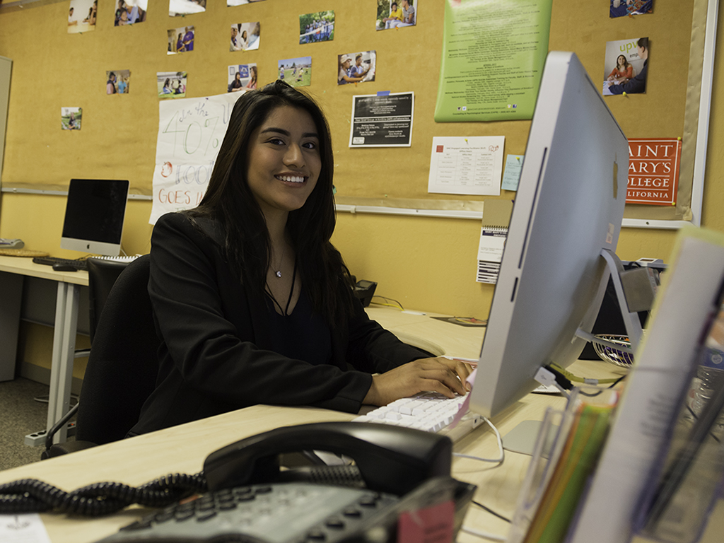 Yarley Martinez '17 sits in front of a computer in CILSA.