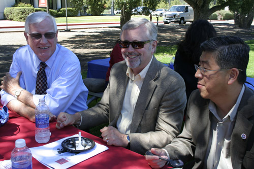 President Jim Donahue, Vice President of Finance Pete Michel and SEBA Dean Zhan Li at the Staff Day barbeque.