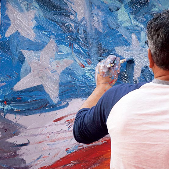 Artist painting American flag.