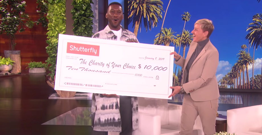 Mahershala Ali and Ellen Degeneres holding a donation check for the Moonlight Scholarship