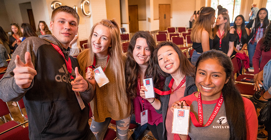 Newly admitted students pose with their event badges at Night-n-Gael