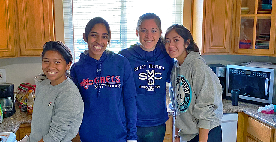 4 gael athletes pose inside a foster group home they are refurbishing