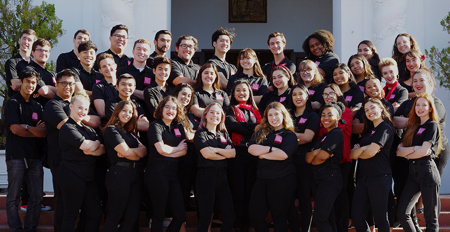 SMC choir poses in front of the chapel