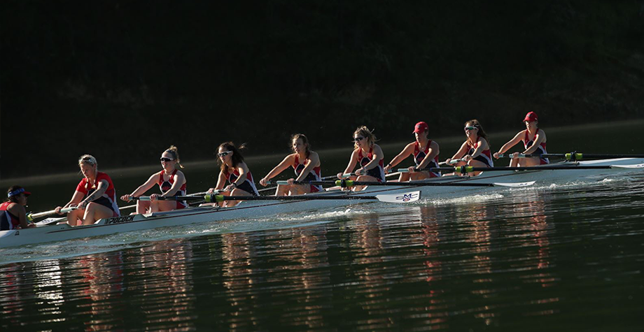 rowing team competes on lake