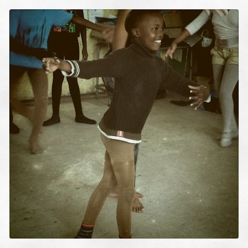 Ten-year-old boy in Khayelitsha prepares for his pirouette.