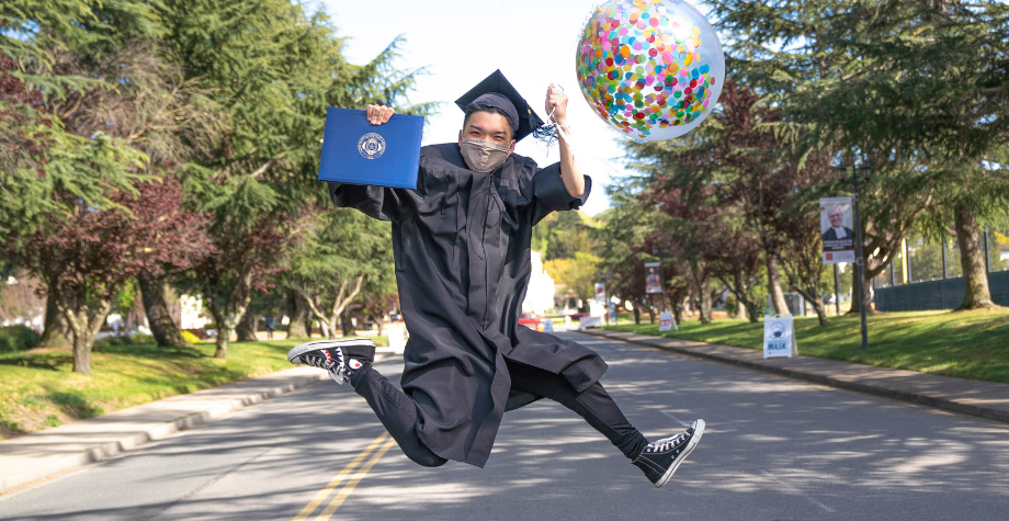 grad jumps in front of chapel