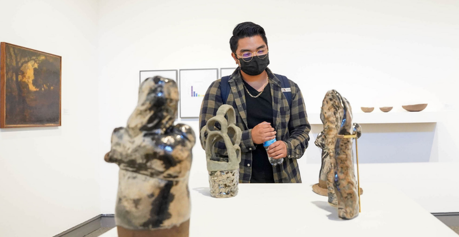 Student explores the Museum of Art