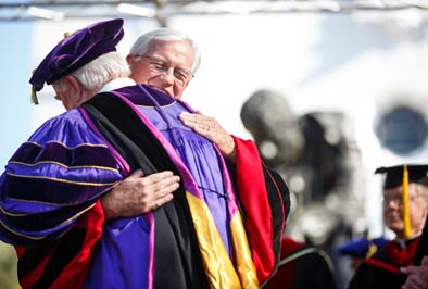 Former President Brother Ronald Gallagher hugs James A. Donahue after his formal investiture as Saint Mary's president.