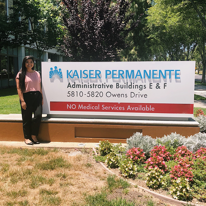 Liselle Ventura in front of the Kaiser Building sign