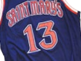[At halftime during a Feb. 21 game against archrival Gonzaga, Saint Mary's fans gave a roaring ovation when President James Donahue and Athletic Director Mark Orr announced that former guard Patty Mills' familiar number 13 would hang in the rafters and never be worn by another Gael. ]