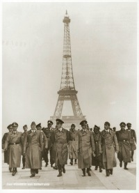 Adolf Hitler and his entourage pose in front of the Eiffel Tower