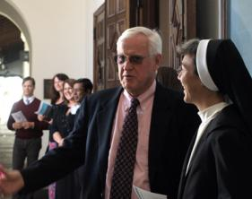 Saint Mary's President Jim Donahue greeted Sister Jodi Min, right, and other Buttimer Institute participants at a Mass on the final day of the program.