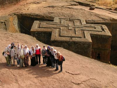 Group at a 12th-century rock-hewn church in Lalibela