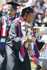 Jazo Moises celebrates during the commencement ceremony.