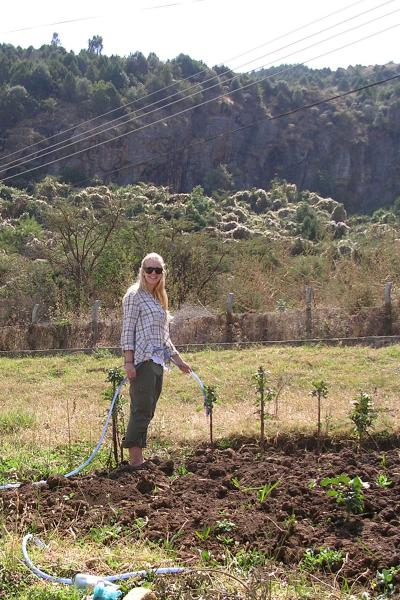 Kristen Langer waters a garden at Desta Mender, a rehabilitation facility run by the Addis Ababa Fistula Hospital