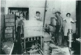 Mary Sabatte helps in the milk processing room at the South Berkeley Creamery in 1913.