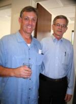 Construction supervisor Kevin Shea '79 (left) caught up with his old football coach, Joe Kehoe.