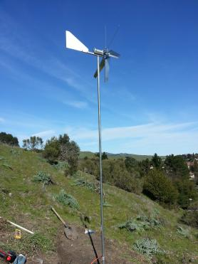 The windmill is powered by wind coming over the hill above the Legacy Garden.
