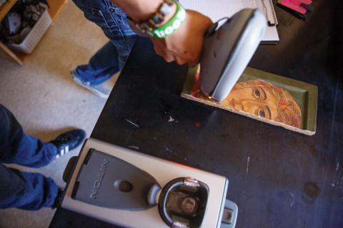 Graduate student analyzes the chemical properties of a Russian icon fragment.