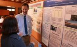 Chemistry professor Steve Bachofer at a poster session.