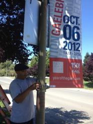 Jorge Gomez of Facilities Services installs one of many banners across campus announcing the Oct. 6, 2012 GAELEBRATION! The free public festival will celebrate the Year of the GAEL, Saint Mary's 150th anniversary.