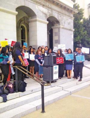 On Cal Grant Lobby Day, Saint Mary's sophomore Jessi Bailey (at podium) and other students took their campaign to save Cal Grant funding to the legislature in Sacramento.