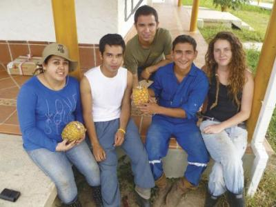No Borders: Mynor Maldonado (center) discovered his life's work among students he mentored in Utopia.
