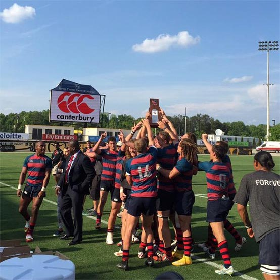 Rugby team celebrating championship.