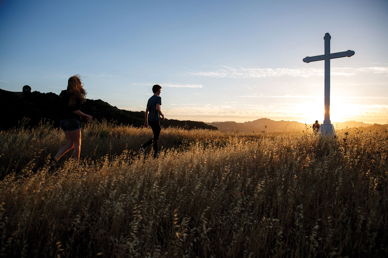 Students hiking to the cross.