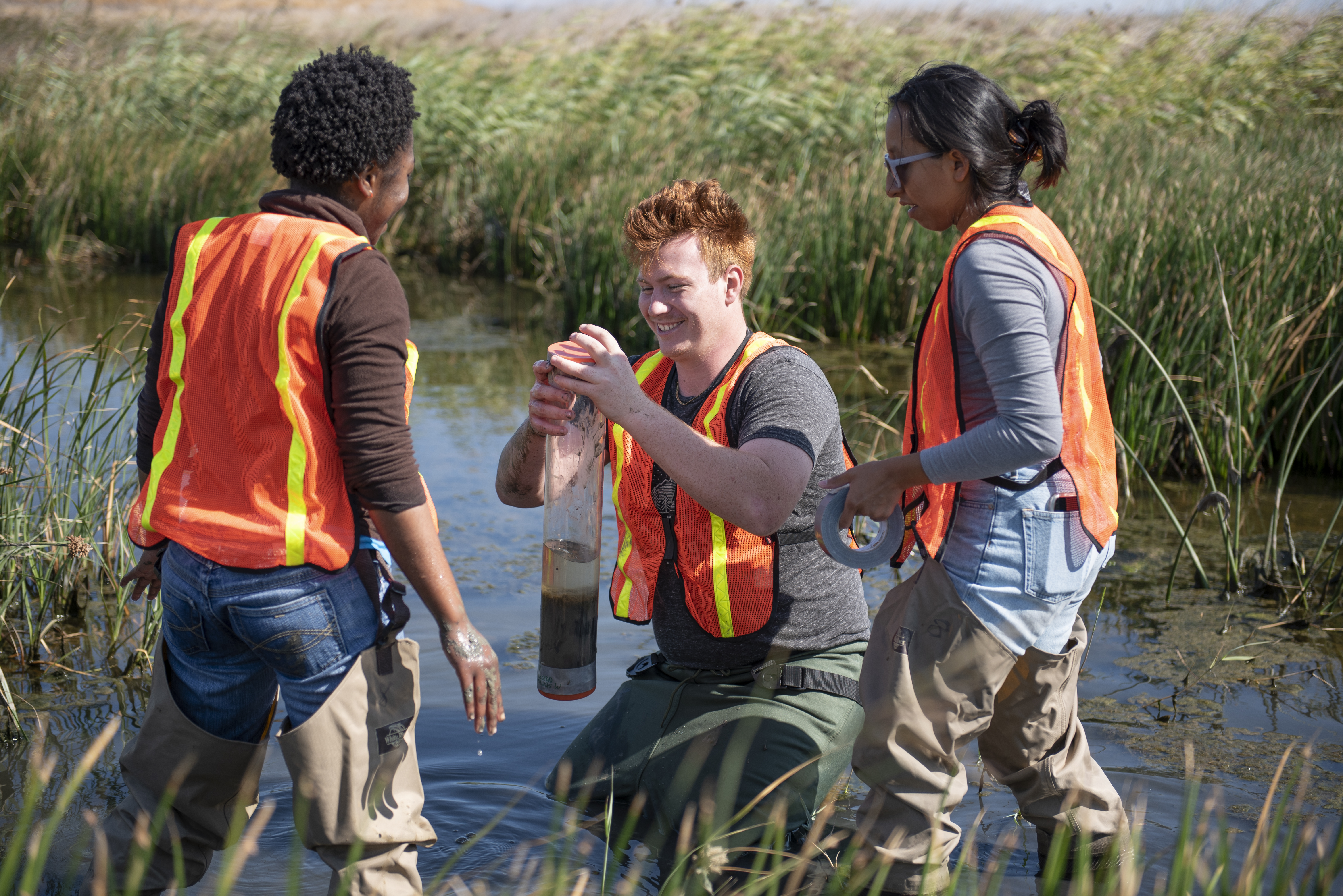Field assistant Ben Harte '22 assists Nelson and Professor Williams with a core sample