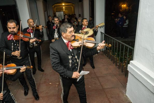 mariachi band plays as they walk through the halls on the last night of Our Lady of Guadalupe week