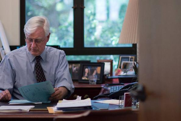 President James Donahue at his desk.