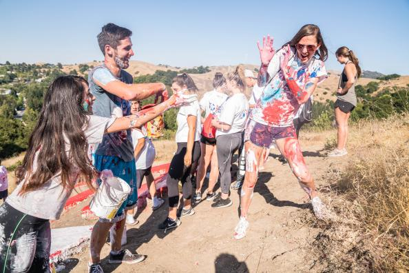 Students throw paint on each other during Painting of the SMC on Saturday, August 26.