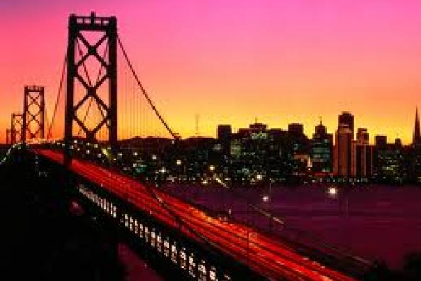 Bay Bridge at sunset, looking from Oakland into the city of San Francisco.