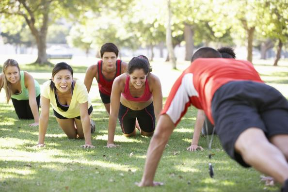Students doing push-ups on the chapel lawn.