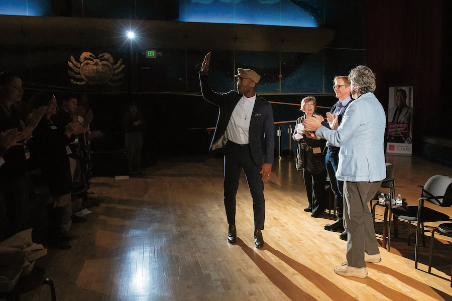 Mahershala Ali '96 waves to the audience at the Rheem Theatre Green Book screening, along with filmmakers Peter Farrelly and Jim Burke and Professor Rebecca Engle.
