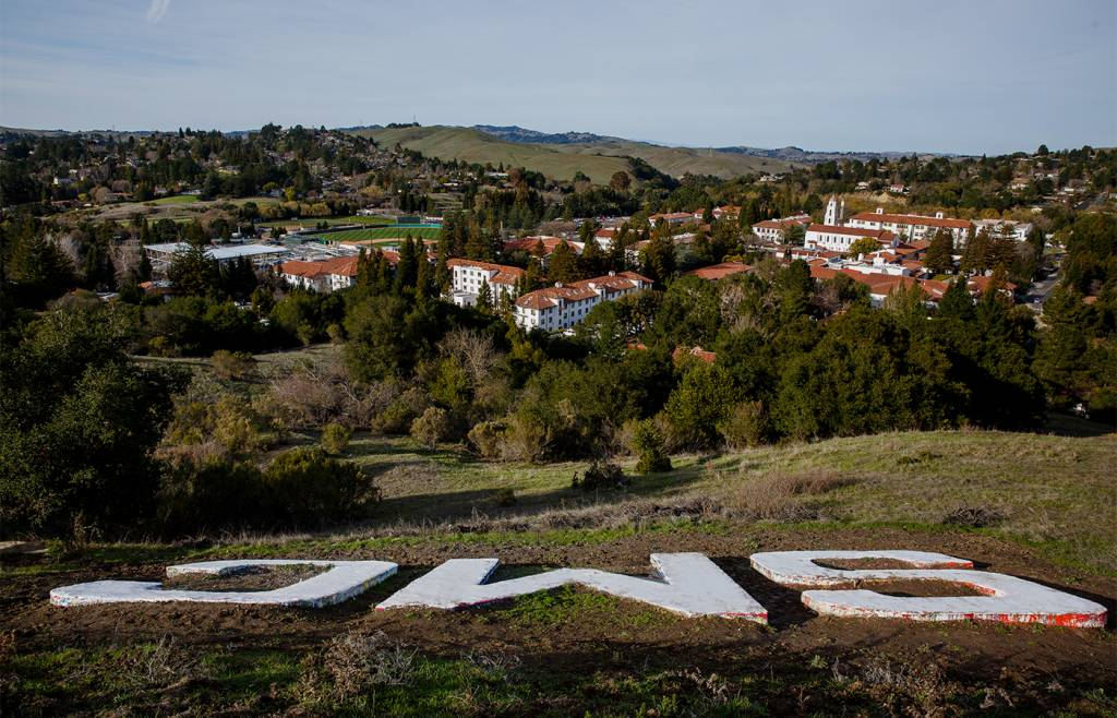 An aerial view of the Saint Mary's campus with the SMC letters in the foreground.