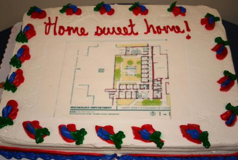 The cake featured an architectural plan of the new center.