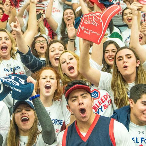 A cheering crowd in McKeon Pavilion