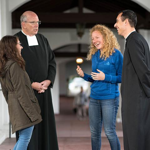 Brother Chris Brady (left) talks with students and Brother Chris Patino