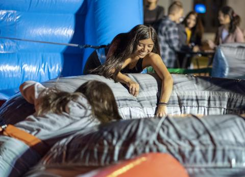 New Students play games, eat cotton candy, and celebrate at the campus Carnival