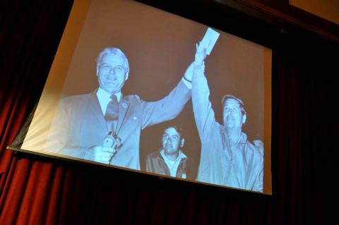 A slide show featured a photo of John Henning with Cesar Chavez.