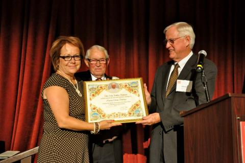 Maria Elena Durazo '75 and John Moylan with a papal blessing presented by Saint Mary's President James A. Donahue.