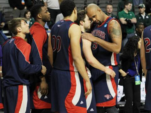 Matthew Dellavedova and Kyle Rowley share a moment after the Gaels' NCAA second round game against Memphis.