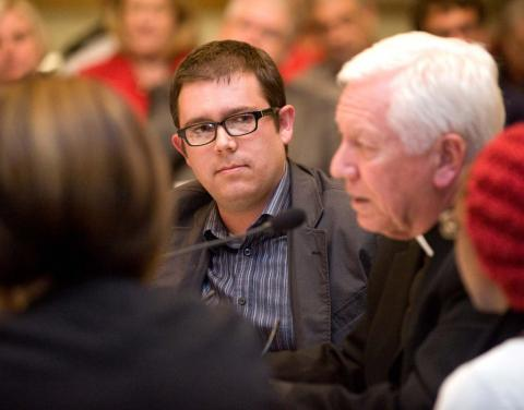Saint Mary's student William Conable listens to Monsignor Robert Sheeran, former president of Seton Hall University.
