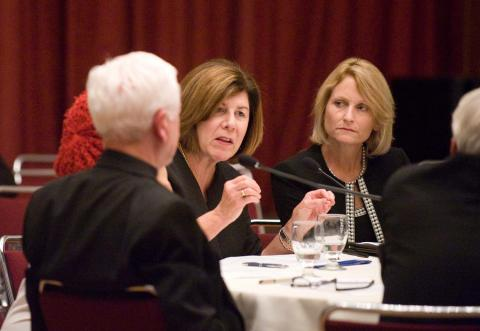 Provost Beth Dobkin (right) listens as Lyons makes a point.