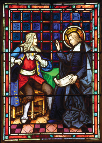 "8. The Young Visitor: This window shows a respectful conversation between two men, although their gestures speak of different temperaments and perhaps different visions.  One appears to be young, wealthy and perhaps impatient. De La Salle seems to be saying ""Wait a minute, slow down."" He holds a scroll that may be an architectural plan for a school, which the young man, possibly Jean-Charles Clement, hoped to support as a training seminary for poor country school masters, perhaps urging a beginning without funding.  Later Clement's zeal waned, and he and his father backed out of the plan, something that sometimes happened to De La Salle as he sought support for his schools."